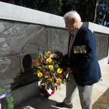 At the Korean War Memorial service, Peter Elliott lays a wreath in behalf of The Church of Jesus Christ of Latter-day Saints.