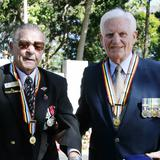 "Denis Hartnet (left) and Latter-day Saint Peter Elliott wearing the ""Ambassador for Peace"" medals"