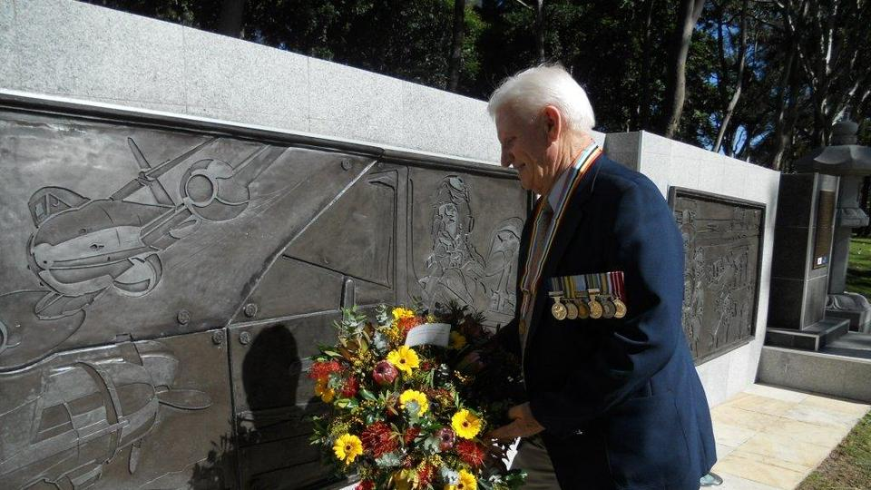 Peter Elliott lays wreath for the Church