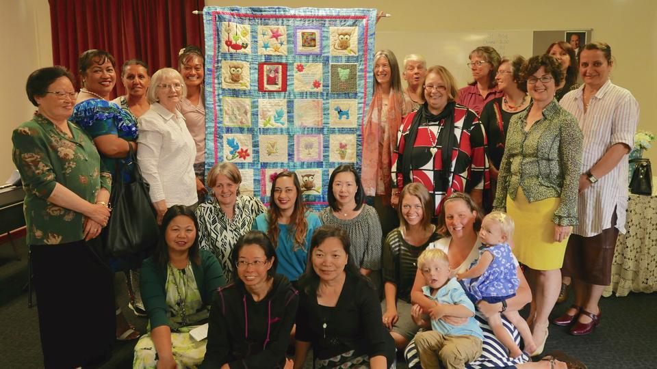 Fairfield Ward Relief Society Members Gather Around their Quilt